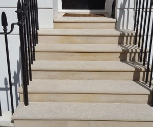 washing of stone steps in London, after photo